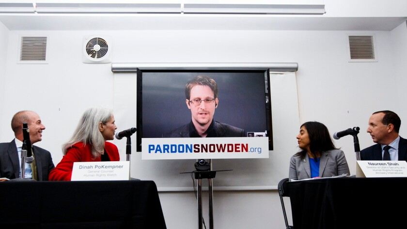 Edward Snowden, via satellite from Moscow, Russia, speaks about a new campaign to persuade President Obama to pardon him, in New York on Sept. 14.