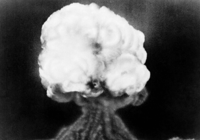 FILE - This July 16, 1945, file photo, shows the mushroom cloud of the first atomic explosion at Trinity Test Site near Alamagordo, N.M. A fight is raging in courts and Congress over where radioactive materials should be stored and how to safely get the dangerous remnants of decades of bomb-making and power generation to a permanent resting place. (AP Photo/File)