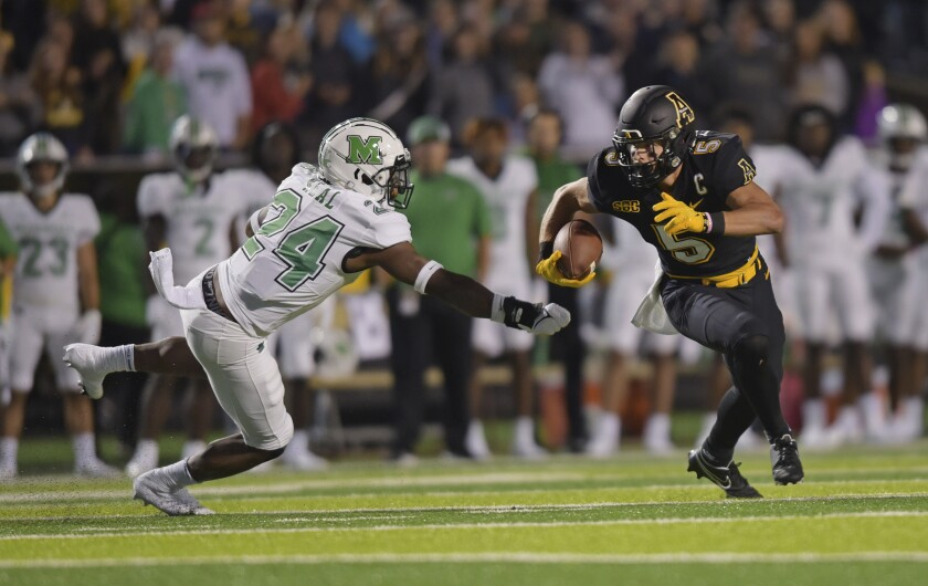 CORRECTS TO SEPT. 23 NOT 2 - Appalachian State wide receiver Thomas Hennigan, right, gets past Marshall linebacker Eli Neal after a reception in the first half of an NCAA college football game, Thursday, Sept. 23, 2021, at Kidd Brewer Stadium in Boone, N.C. (Walt Unks/The Winston-Salem Journal via AP)