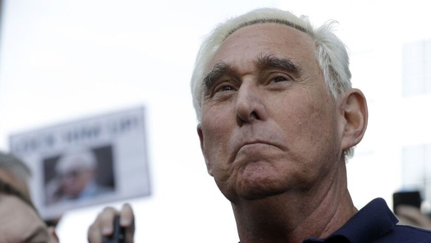 Roger Stone, a confidant of President Donald Trump, walks out of the federal courthouse following a hearing on Jan. 25 in Fort Lauderdale, Fla.