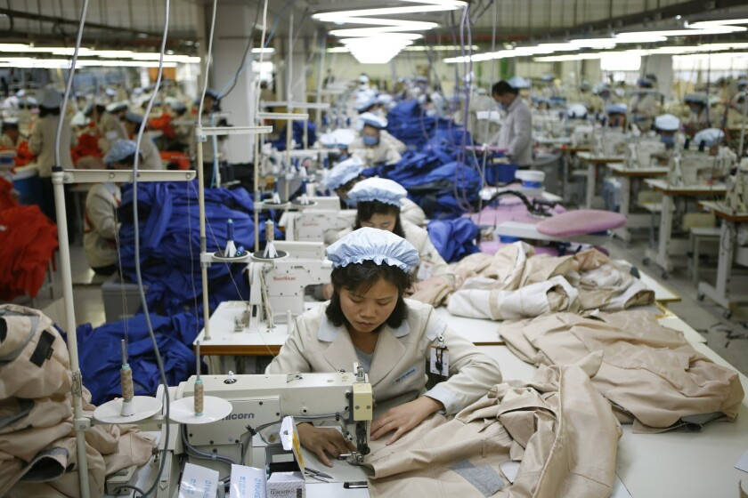 FILE - In this Dec. 19, 2013, file photo, North Korean workers assemble jackets at a factory of a So