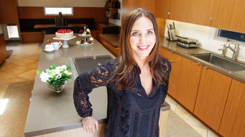 SAN DIEGO, CA March 21st 2018 | Karen Krasne, chef/owner of Extraordinary Desserts, stands in the ki