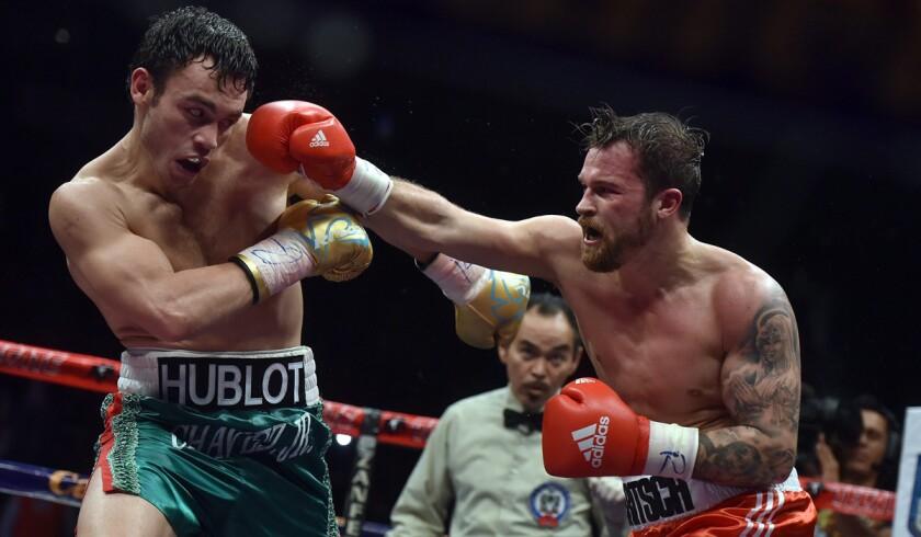 Julio Cesar Chavez Jr., left, faces Dominik Britsch in December in Monterrey, Mexico. Chavez's unanimous-decision win was his 50th victory.