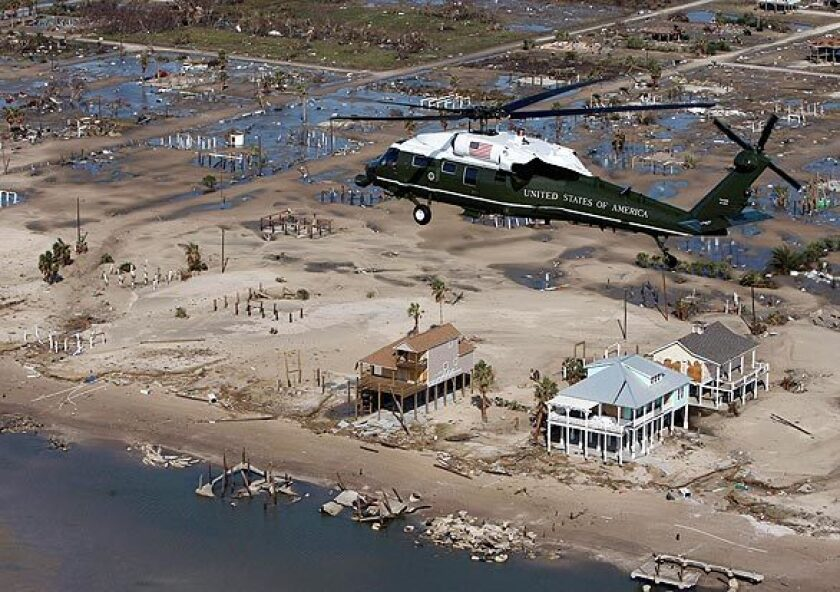 Marine One, with President Bush aboard, takes an aerial tour of the damage from Hurricane Ike near Galveston, Texas.