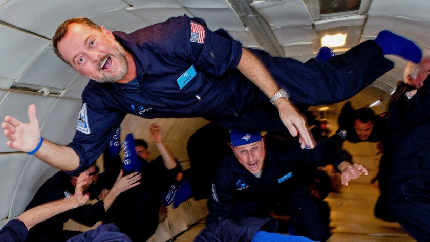 Technology executive David Moore revels in the zero-gravity experience in 2016. Moore plans to atten