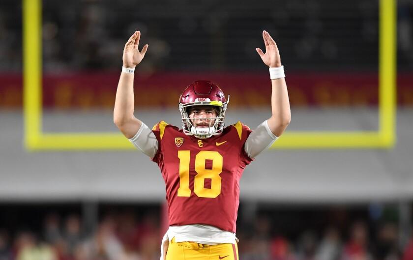 USC quarterback J.T. Daniels signals touchdown on a catch by Michael Pittman Jr. against Washington State last season.