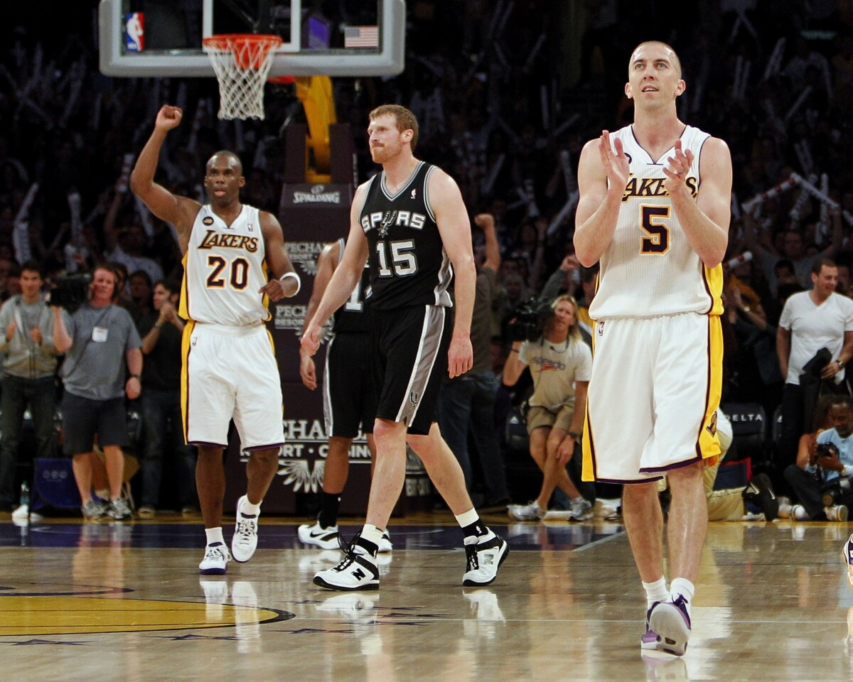 Lakers point guard Steve Blake (5), who finished wiht 23 points, and guard Jodie Meeks (20) begin to celebrate in the final seconds of a 91-86 victory over the San Antonio Spurs on Sunday night at Staples Center.