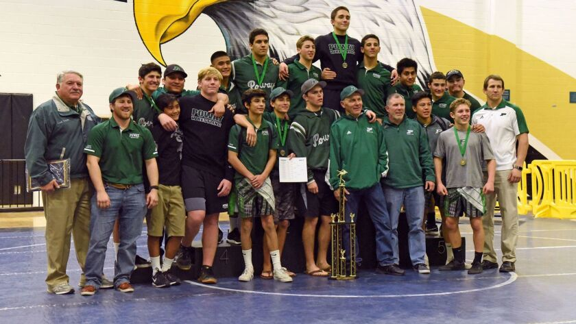 The Poway Titan wrestling team poses after capturing the team championship, scoring 369.5 points and