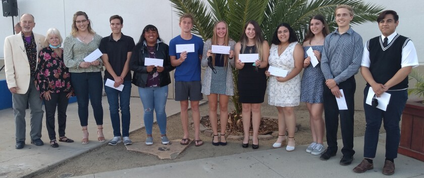 Ramona Rotary Club, represented by Rotary President Eric Shapira and his wife Susan, left, award $8,000 in scholarships.