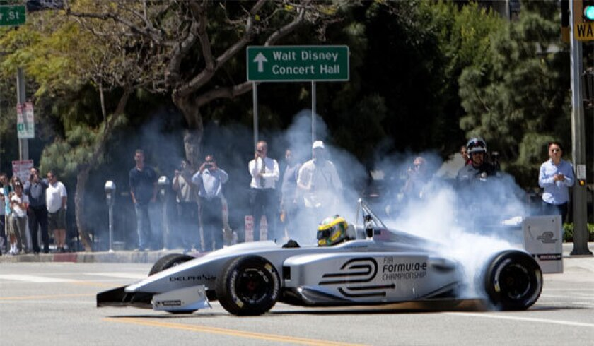 Driver Lucas Di Grassi spins his wheels making doughnut turns while demonstrating the new Formula E electric race car prototype in downtown Los Angeles in April.