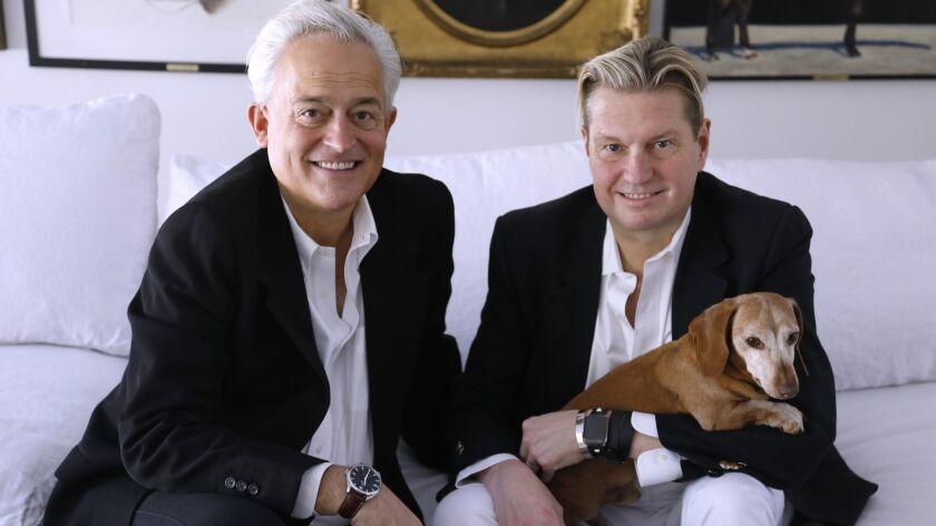 BEVERLY HILLS, CA - JANUARY 4, 2019 - - Fashion designers Mark Badgley, left, and James Mischka, hol