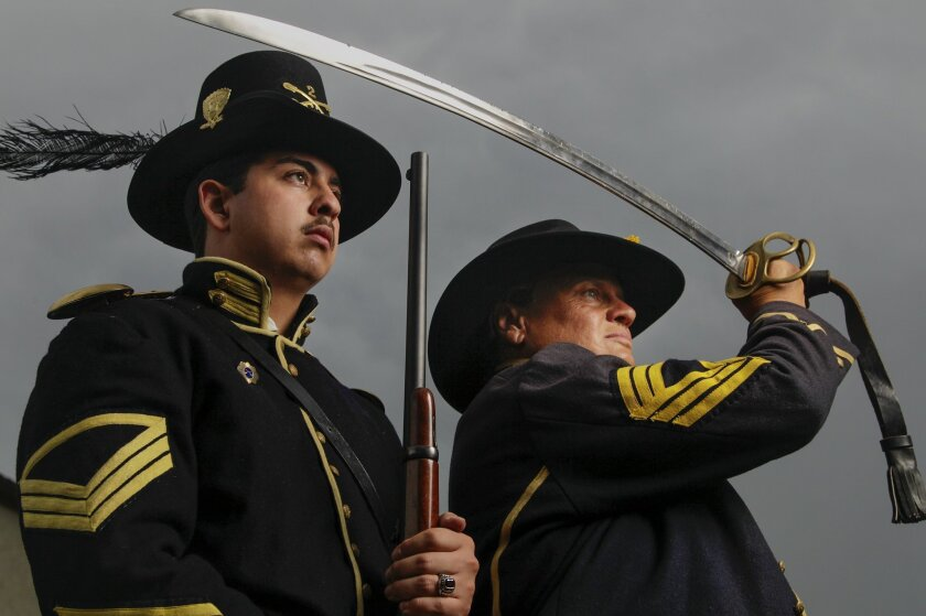 Civil War re-enactors (from left) Quartermaster Sgt. AJ Gonzalez, Sgt. Major Jean Roberts (as Sgt. Major Hal Roberts)(a female), pose for a photo in their Civil War uniforms on Tuesday in San Diego, California. They are participating in the reburial of Civil War veteran Charles Schroeter.