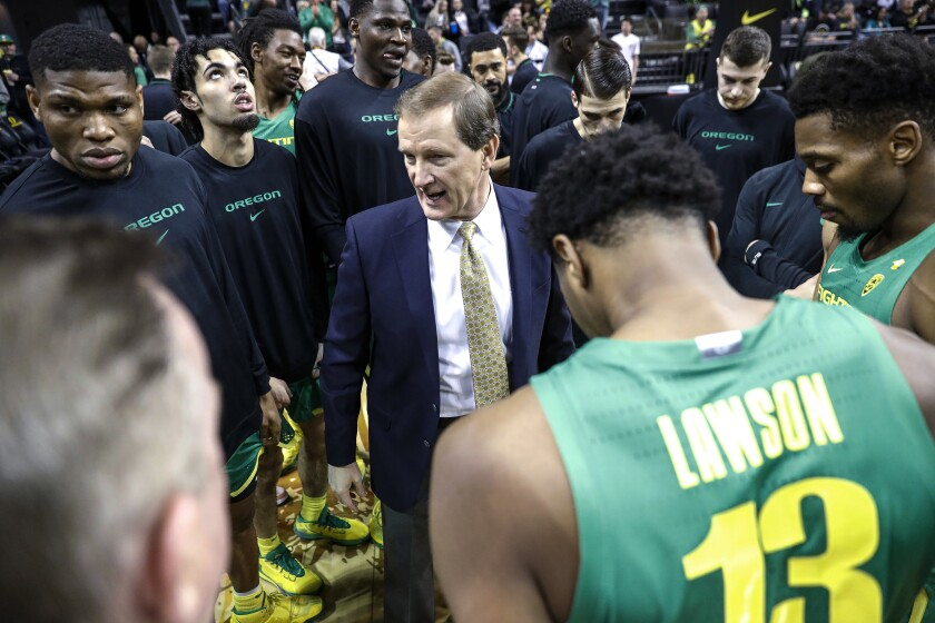 Oregon coach Dana Altman talks to the team before a game against Stanford.