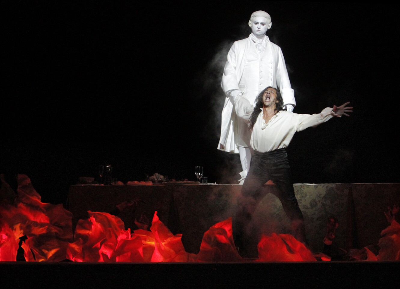 """Ildebrando D'Arcangelo, front, as Don Giovanni and Ievgen Orlov as Commendatore at the dress rehearsal of """"Don Giovanni"""" at the Dorothy Chandler Pavilion in Los Angeles."""