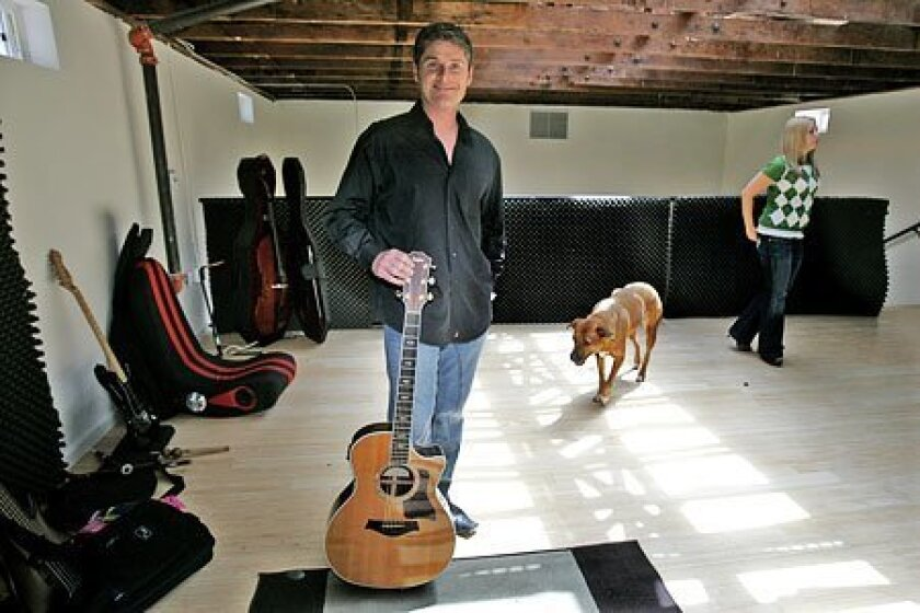 TakeLessons.com founder Steven Cox with his dog, Nutty, and the site's director of marketing, Jill Strasser. (Eduardo Contreras / Union-Tribune)