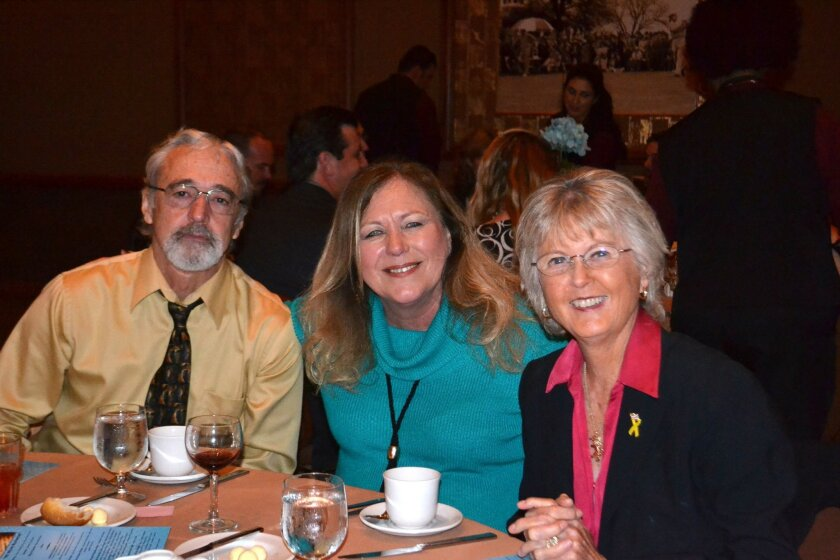 Steve Butler and Carol Fowler visit with county Supervisor Dianne Jacob, right, during dinner.