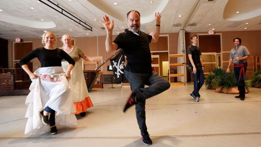 """Seán Curran directs actors during a rehearsal for San Diego Opera's """"The Pirates of Penzance."""""""