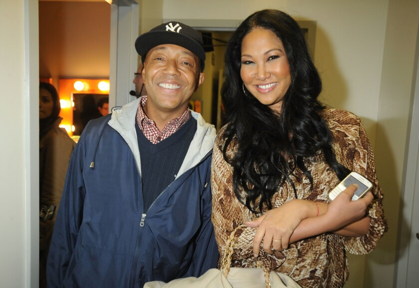 In this handout photo provided by MTV, producer Russell Simmons (L) and designer Kimora Lee at the Hope For Haiti Now: A Global Benefit For Earthquake Relief telethon on January 22, 2010 in Los Angeles, California.