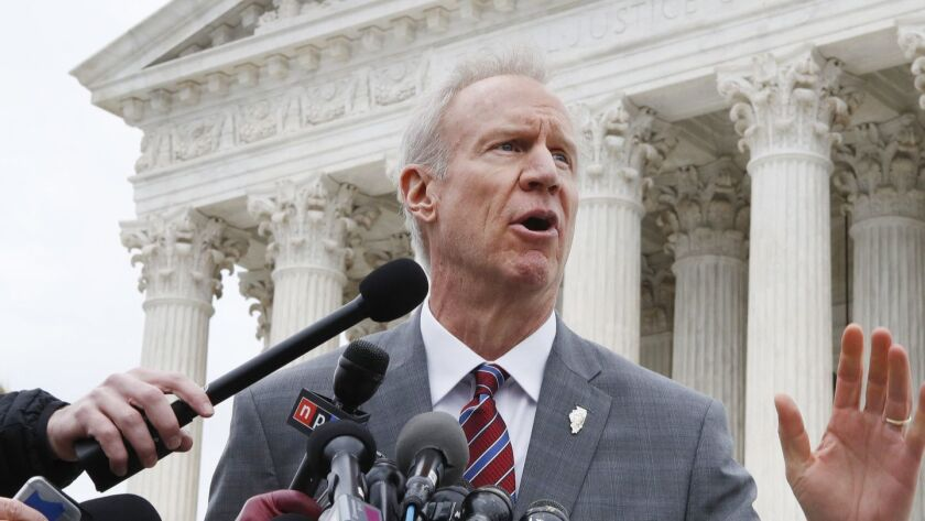 Illinois Gov. Bruce Rauner stands outside the Supreme Court in Washington in February. Rauner launched the original case that resulted in the court's ruling on so-called fair share union fees.