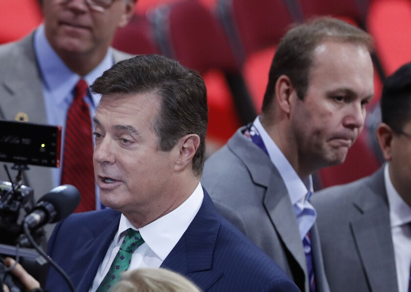 Paul Manafort, left, and his aide Rick Gates on the floor of the Republican National Convention in Cleveland on July 17, 2016.
