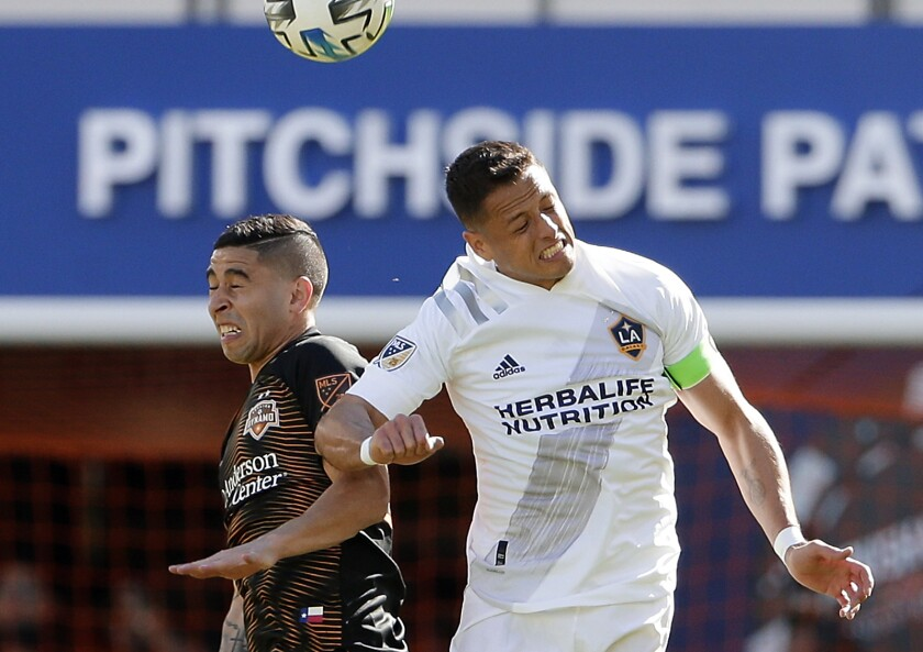 "Dynamo midfielder Matías Vera, left, and Galaxy forward Javier ""Chicharito"" Hernández battle for the ball in a 1-1 draw Feb. 29, 2020."