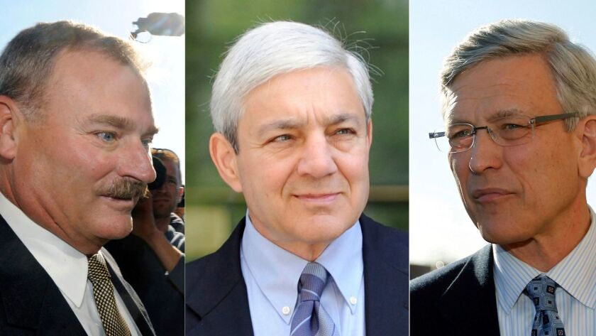FILE – This file photo combination shows former Penn State vice president Gary Schultz, left, form