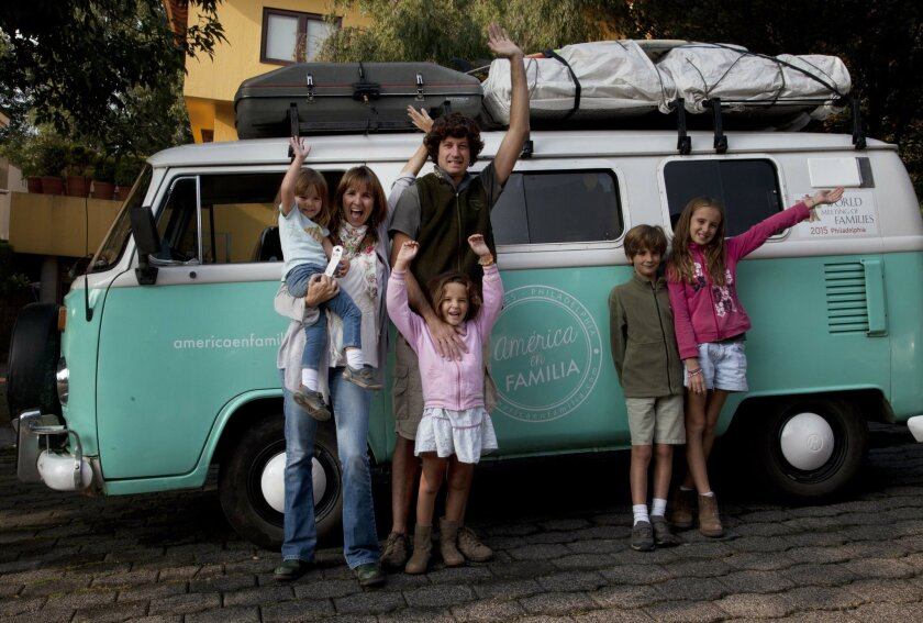 Catire Walker, 41, his wife, 39, and their four children, Carmin, 3, from left, Mia, 5, Dimas, 8, and Cala, 12, pose for a photo in front of their Volkswagen Kombi, in Mexico City, Saturday, Aug. 22, 2015. The Argentine couple piled their four children into the VW Transporter in Buenos Aires in March to travel to Philadelphia to see Pope Francis at the Festival of Families in September. (AP Photo/Marco Ugarte)