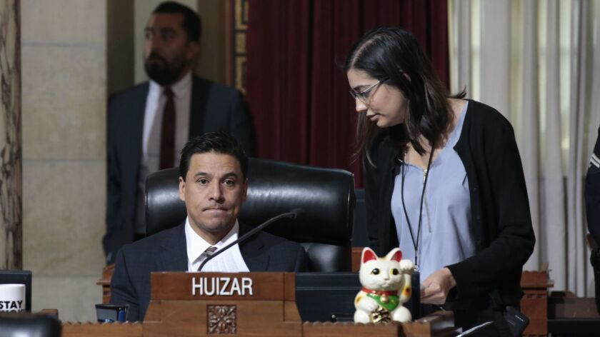 Los Angeles City Councilman Jose Huizar, seated at a council meeting in 2018 with an unidentified person next to him.