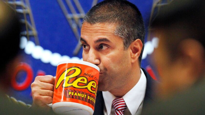FCC Chairman Ajit Pai drinks from a mug during the Dec. 14 meeting in which his commission voted to end net neutrality rules.