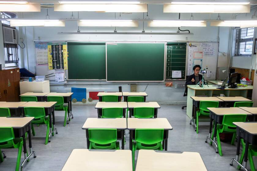 A teacher in Hong Kong records a video lesson for students who have had classes suspended due to the coronavirus.