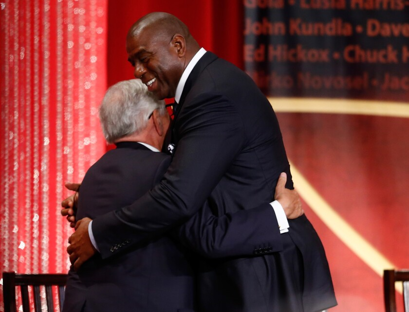 "David Stern, left, and Earvin ""Magic"" hug Johnson during the 2014 Basketball Hall of Fame Enshrinement Ceremony."