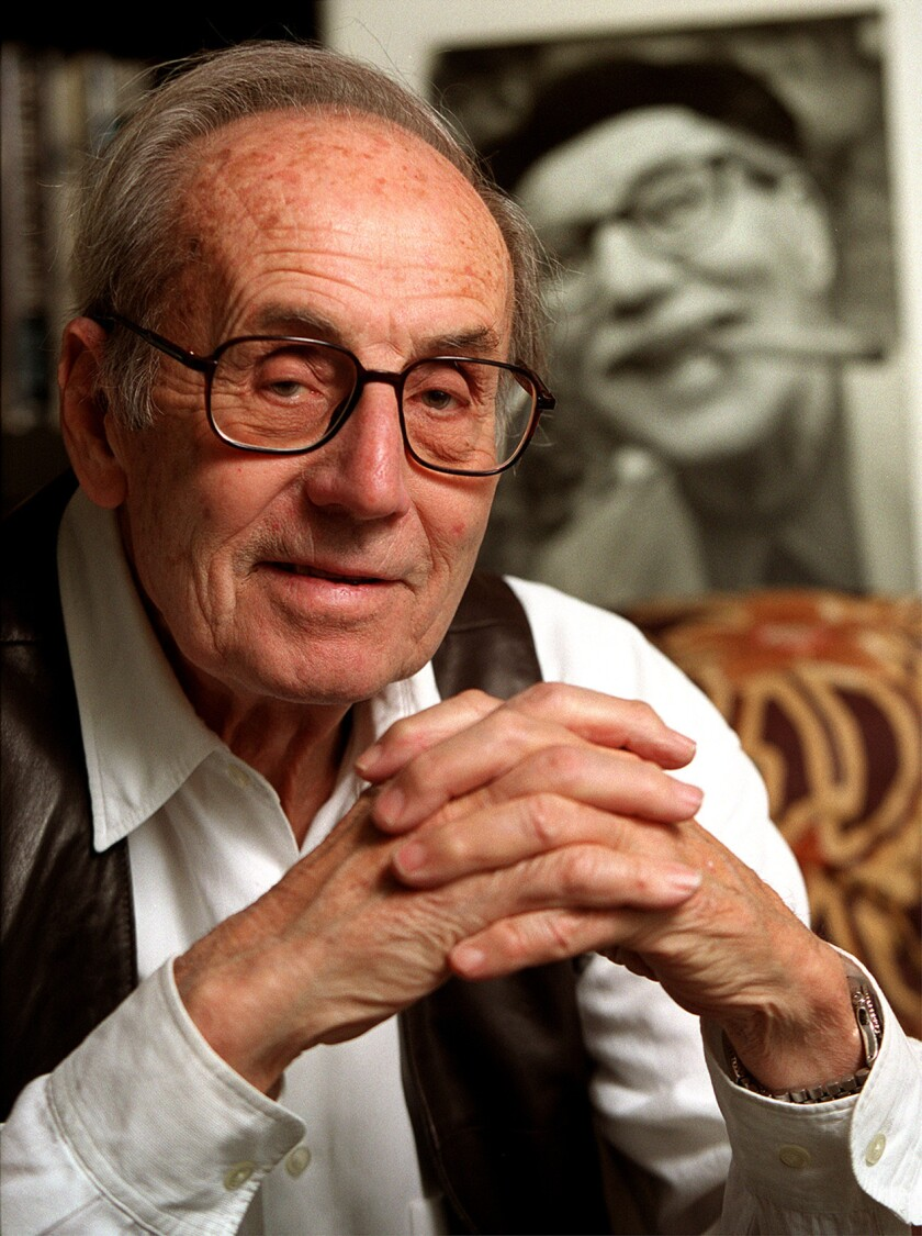 Arthur Marx in 2000, with photo of his father Groucho in background.