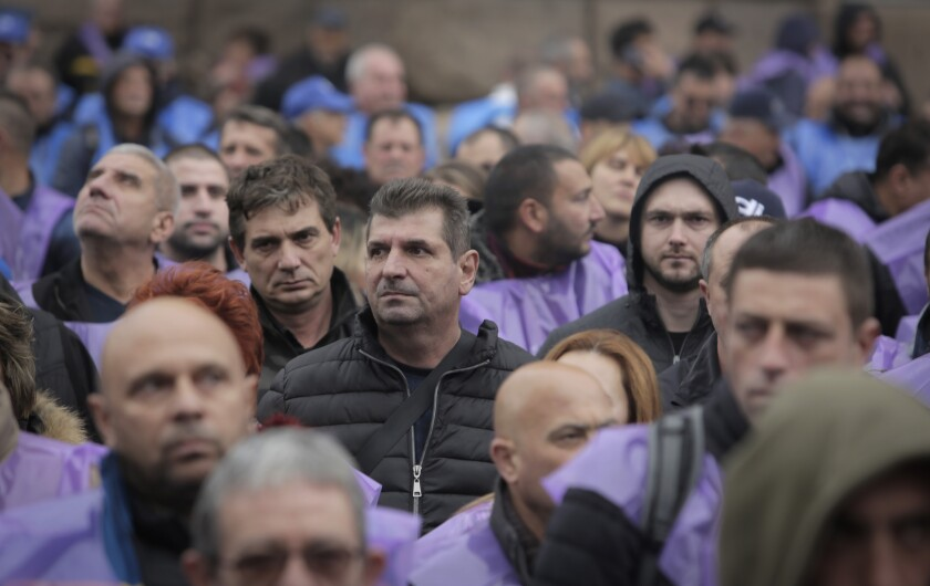 Hundreds of Bulgarian coal miners and energy workers stage a protest in Sofia, Bulgaria, Wednesday, Oct. 13, 2021, to demand government guarantees for their jobs amid bids by the European Union to close mines and reduce carbon emissions. The financial burden of reducing carbon emissions poses a huge challenge to Bulgaria, which has one of the lowest GDP per capita rates in the EU. (AP Photo/Valentina Petrova)