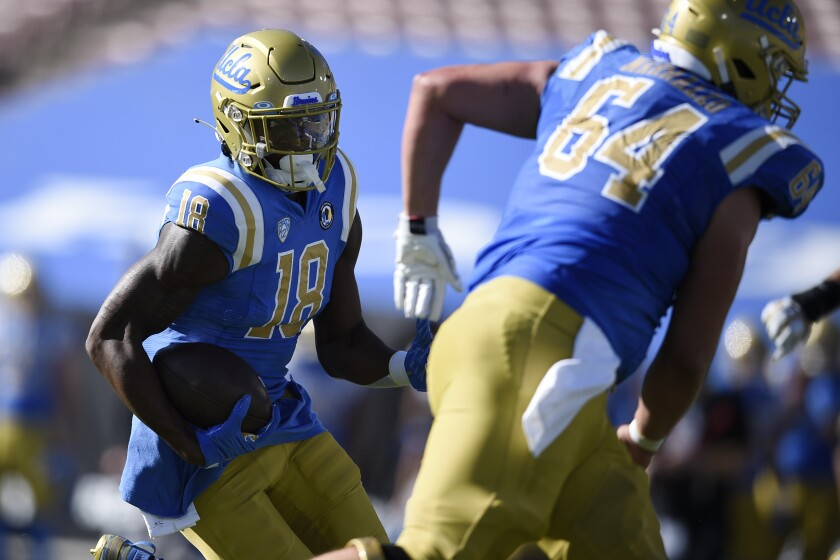 UCLA wide receiver Charles Njoku runs after a catch for a touchdown against California.
