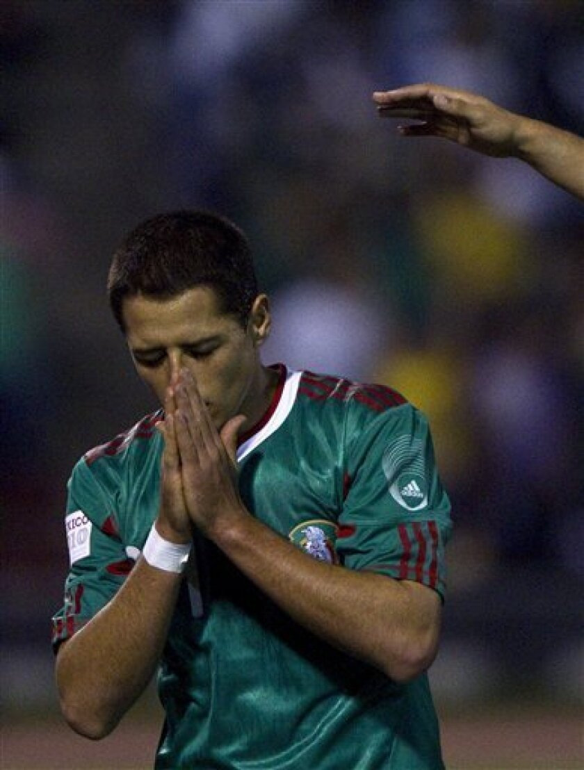Mexico's Javier Hernandez, aka Chicharito, celebrates after scoring against Venezuela during a friendly soccer match at the Benito Juarez stadium in Ciudad Juarez, Mexico, Tuesday, Oct. 12, 2010. (AP Photo/Guillermo Arias)