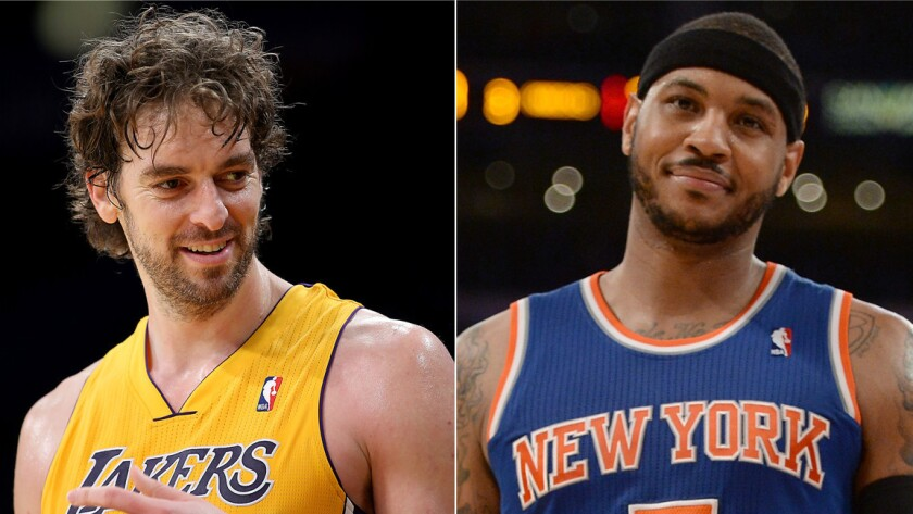 Pau Gasol, left, might consider re-signing with the Lakers if the team is able to land free-agent forward Carmelo Anthony.