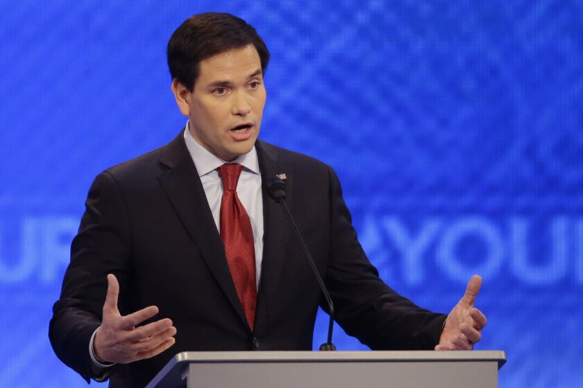 Sen. Marco Rubio of Florida answers a question during the Republican presidential primary debate on Saturday at St. Anselm College in Manchester, N.H.