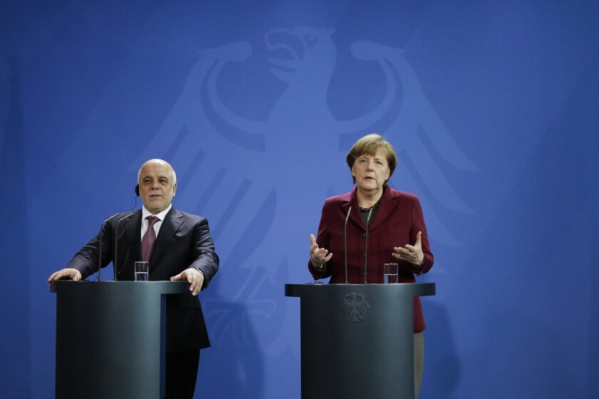 German Chancellor Angela Merkel, right, and Iraqi Prime Minister Haider al-Abadi, left, attend a joint press conference at the chancellery in Berlin, Thursday, Feb. 11, 2016. (AP Photo/Markus Schreiber)