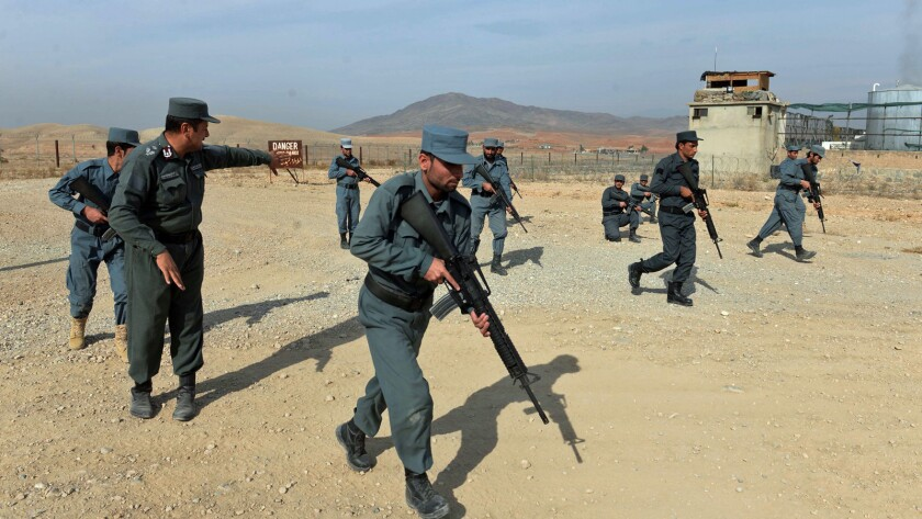 Afghan policemen display their skills at a training center on the outskirts of Jalalabad in Nangarhar province.