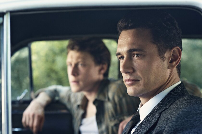"""This image released by Hulu shows James Franco as Jake Epping, right, and George MacKay as Bill Turcotte in a scene from the eight-part series, """"11.22.63,"""" streaming on Hulu beginning Monday, Feb. 15, 2016. (Sven Frenzel/Hulu via AP)"""