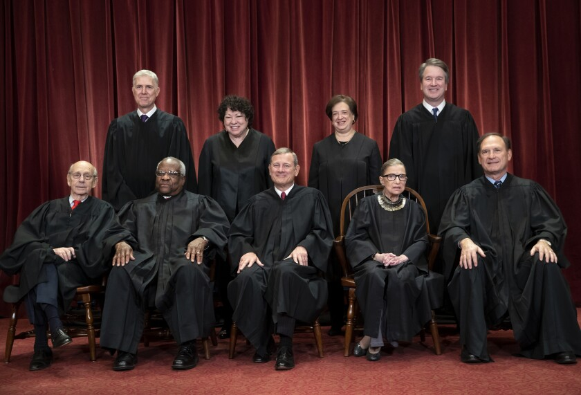 The justices of the U.S. Supreme Court gather for a formal group portrait in 2018.
