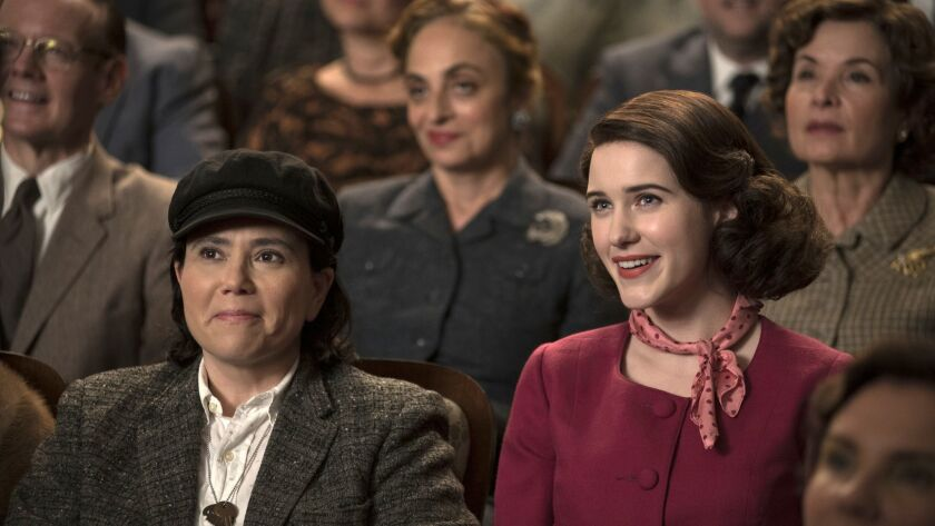 This image released by Amazon shows Alex Borstein as Susie Myerson, left, and Rachel Brosnahan as Mi