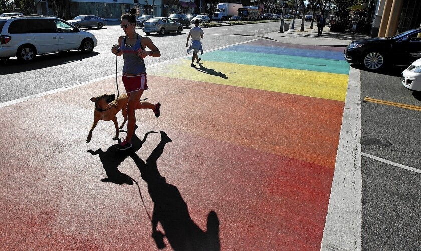 Though West Hollywood is becoming more diverse, as straight residents and business owners join the hip community, local officials say they have no intention of shying away from the city's historic gay identity, which led to rainbow crosswalks and flags at traffic medians.