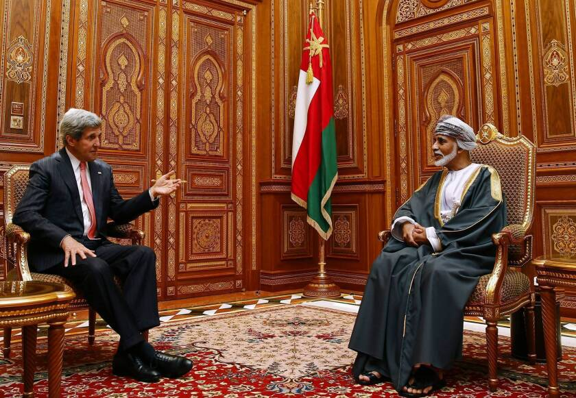 U.S. Secretary of State John F. Kerry, left, meets with Oman's Sultan Qaboos bin Said in the capital city, Muscat, in May. Kerry visited Oman under the guise of pursuing a military deal, but his main goal, officials have said, was to talk with the sultan about the secret U.S.-Iran diplomacy.