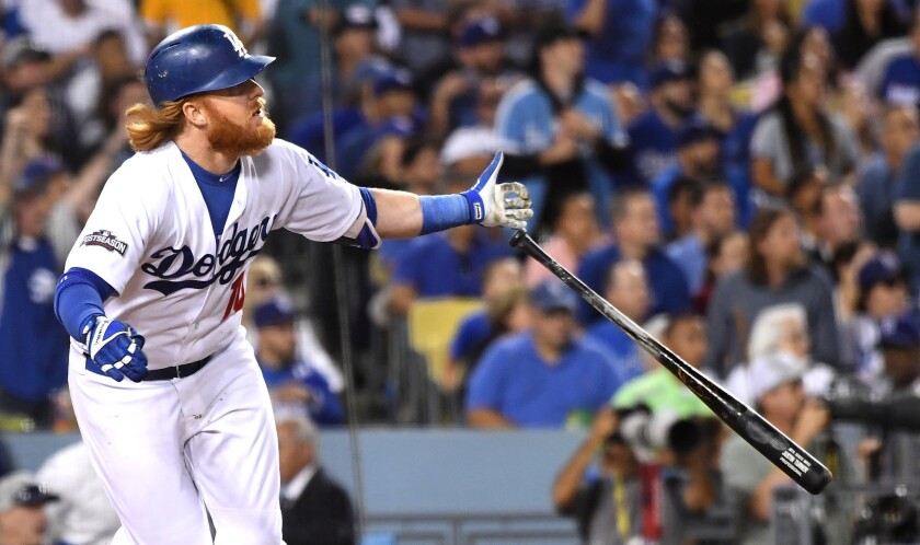 Justin Turner hits a home run during Game 3 of the NLCS.