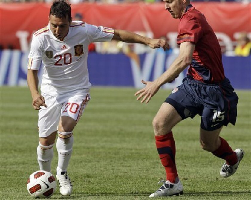 Spain's Santiago Cazorla, left, fights off the defensive pressure of he United States' Tim Ream during the first half of an international friendly soccer match in Foxborough, Mass., Saturday afternoon, June 4, 2011. (AP Photo/Stephan Savoia)