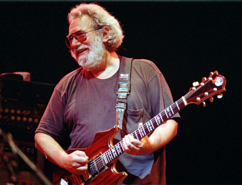 FILE - In this Nov. 1, 1992, file photo, Grateful Dead lead singer Jerry Garcia performs in Oakland, Calif.