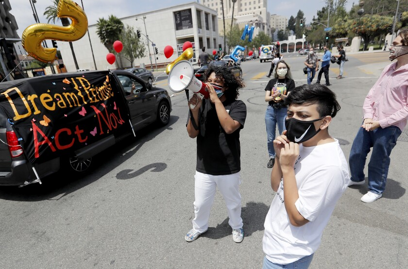 """Dreamers"" and their supporters stage a celebratory car caravan around MacArthur Park in Los Angeles on Thursday."