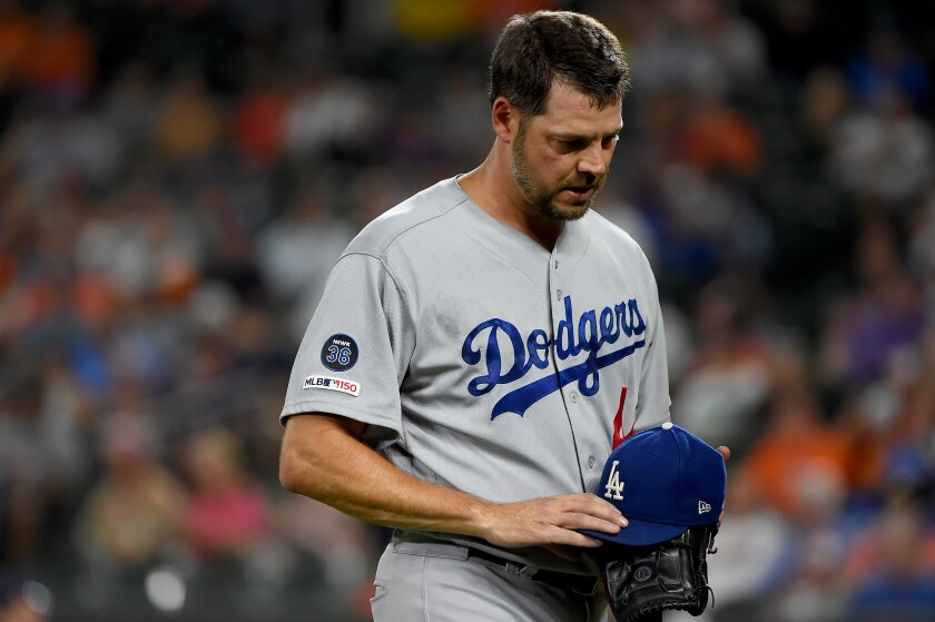Dodgers pitcher Rich Hill leaves in the first inning against the Orioles on Sept. 12, 2019.