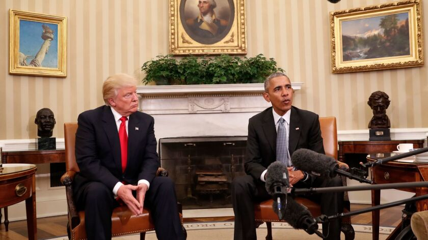 President Barack Obama meets with President-elect Donald Trump in the Oval Office of the White House in Washington.